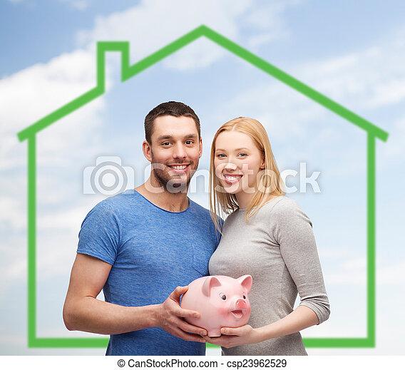 дом, над, зеленый, поросенок, держа, улыбается, пара, банка - csp23962529